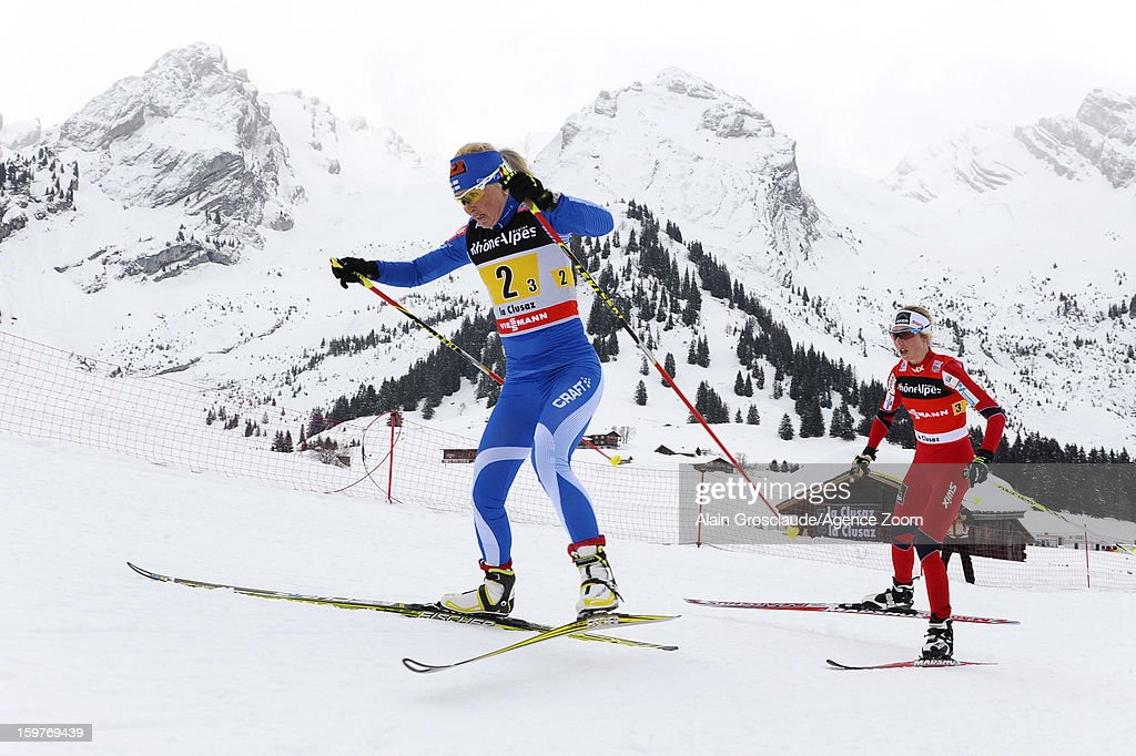 Kristin Stoermer Steira (R) of Norway takes 1st place during the FIS Cross-Country World Cup Women's Relay Start on January 20, 2013 in La Clusaz, France.