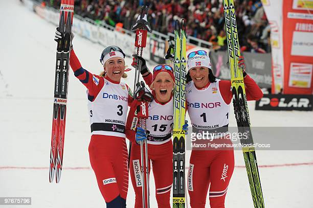 Kristin Stoermer Steira Therese Johaug and Marit Bjoergen of Norway celebrate after the women's 30km Cross Country Skiing during the FIS World Cup on...