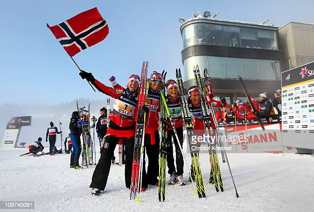 Kristin Stoermer Steira Vibeke Skofterud Therese Johaug and Marit Bjoergen of Norway celebrate after winning the gold medal in the Ladies Cross...