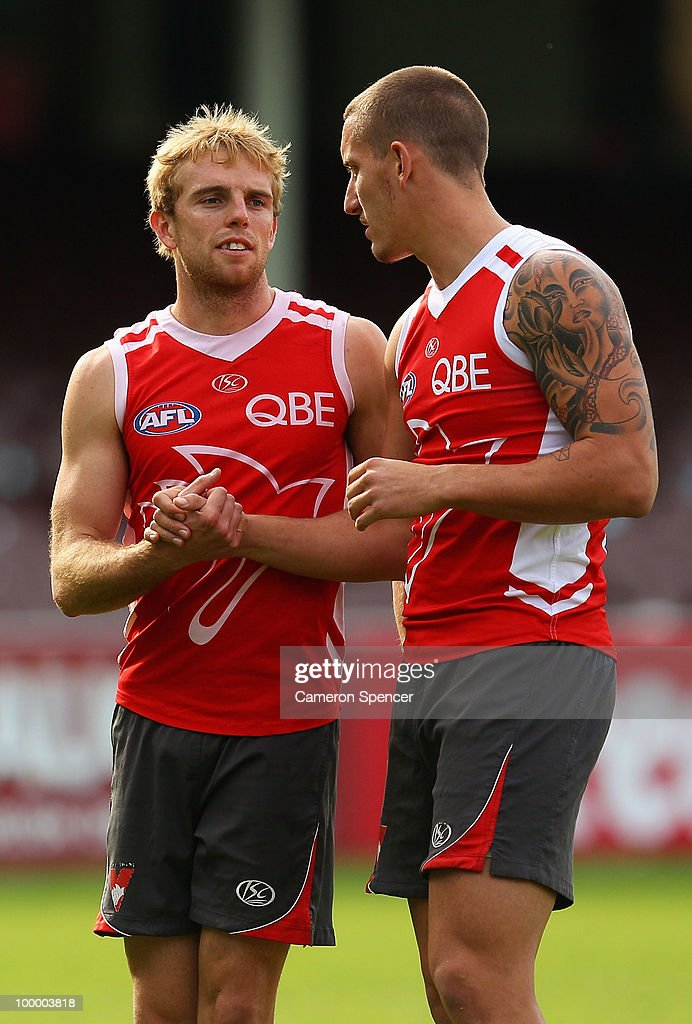 Kristin Thornton and Jesse White of the Swans embrace during a Sydney Swans AFL training session at the Sydney Cricket Ground on May 20, 2010 in Sydney, Australia.