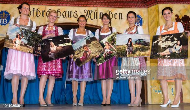 Kristina Anna Michelle Magdalena Justine and Franziska stand together and present their calendar pages in Munich Germany 07 October 2014 Each of the...