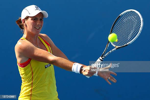 Kristina Barrois of Germany plays a backhand in her first round match against Michaella Krajicek of the Netherlands during day two of the 2012...