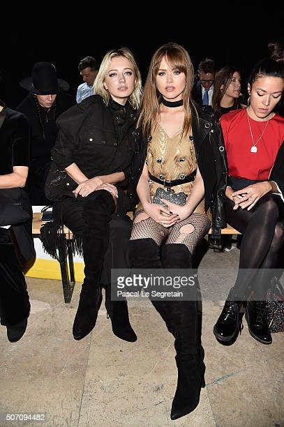 Kristina Bazan and a guest attend the Viktor Rolf Spring Summer 2016 show as part of Paris Fashion Week on January 27 2016 in Paris France