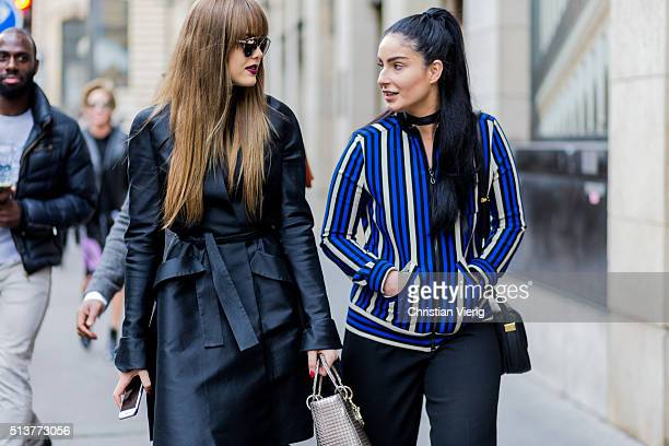 Kristina Bazan is wearing a black coat and Fiona Zanetti outside Dior during the Paris Fashion Week Womenswear Fall/Winter 2016/2017 on March 4 2016...