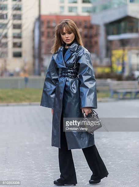 Kristina Bazan is wearing a Dior bag a black Zana Bayne belt a BreeLayne Marla coat seen outside Lacoste during New York Fashion Week Women's...