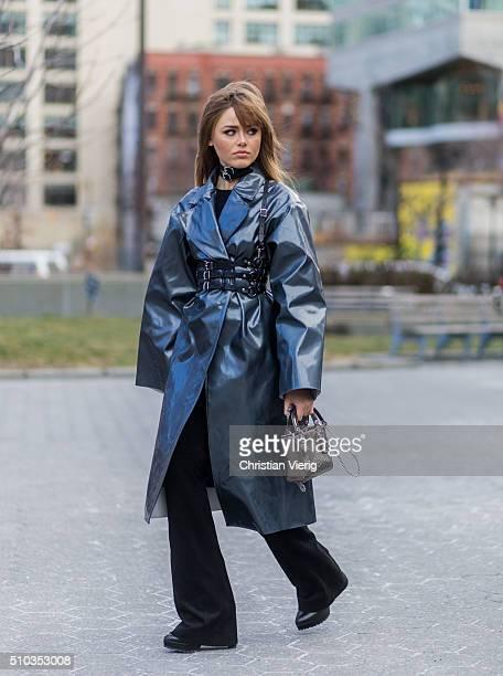 Kristina Bazan is wearing a Dior bag a black Zana Bayne belt a BreeLayne Marla coat seen outside Lacoste during New York Fashion Week Women's...