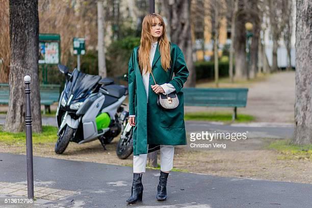 Kristina Bazan wearing a green coat and Chloe bag outside Chloe during the Paris Fashion Week Womenswear Fall/Winter 2016/2017 on March 3 2016 in...