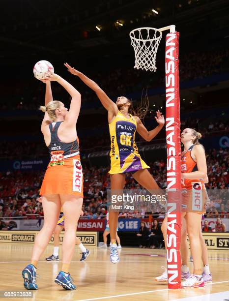 Kristina Brice of the Giants shoots as Geva Mentor of the Lightning defends during the round 14 Super Netball match between the Giants and the...