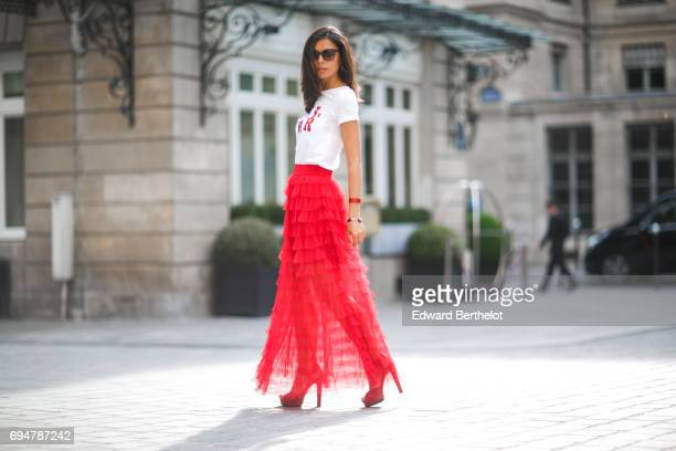 Kristina Castillo wears Gucci sunglasses a Naf Naf white tshirt with the incription 'GRL PWR Girl Power' a Naf Naf red ruffled lace skirt and Gucci...