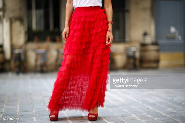 Kristina Castillo wears Gucci sunglasses a Naf Naf white tshirt with the incription GRL PWR Girl Power a Naf Naf red ruffled lace skirt and Gucci...