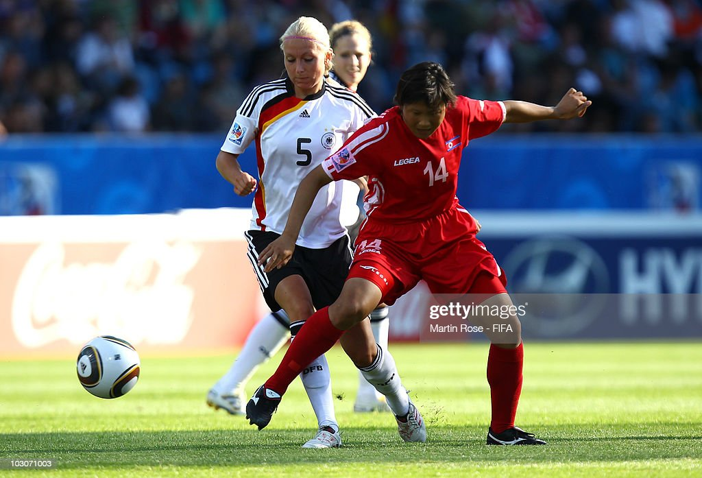 Kristina Gessat (L) of Germany and Hyon Hi Yun (R) of North Korea compete for the ball during the FIFA U20 Women's World Cup Quarter Final match between Germany and North Korea at the FIFA U-20 Women's World Cup stadium on July 24, 2010 in Bochum, Germany.