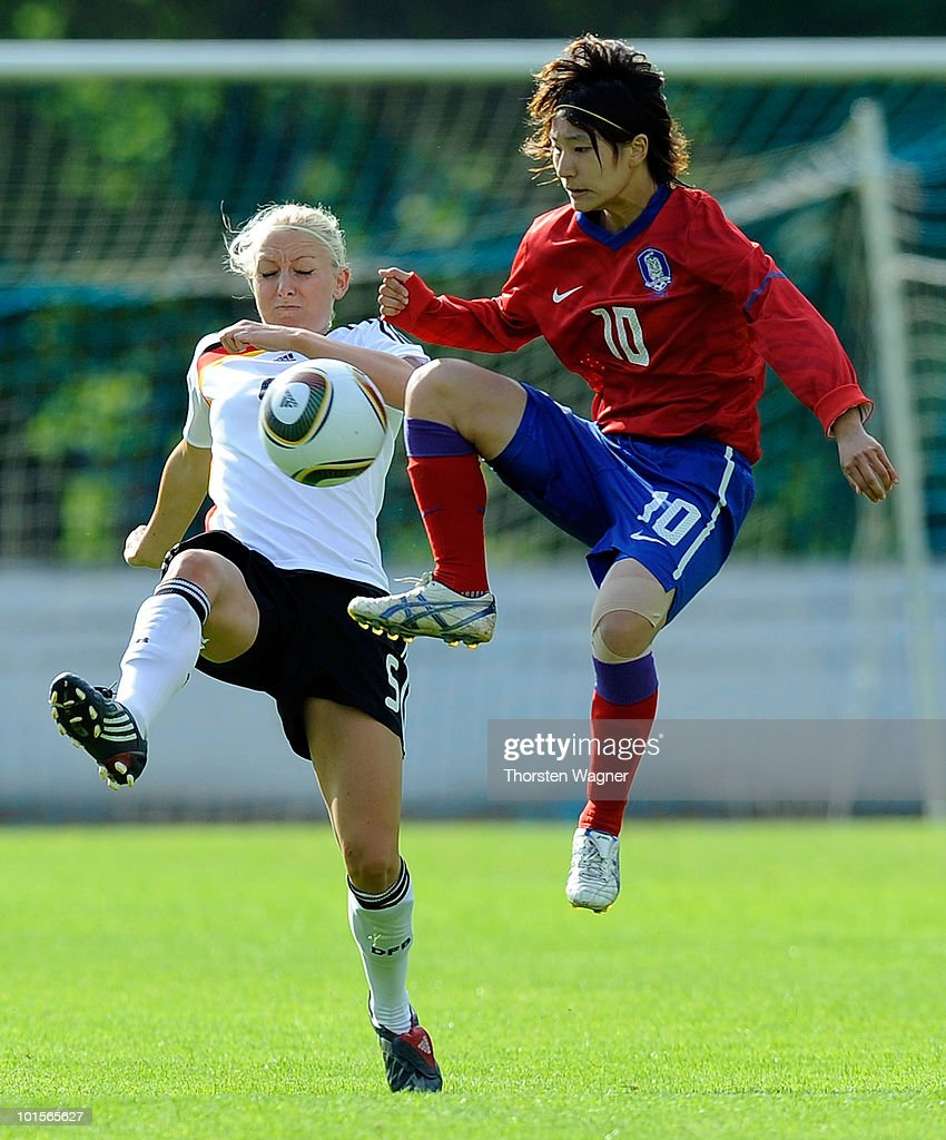 Kristina Gessat (L) of Germany battles for the ball with Kang Yumi (R) of South Korea during the U20 international friendly match between Germany and South Korea at Waldstadion on June 2, 2010 in Giessen, Germany.