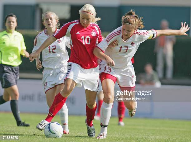 Kristina Gessat of Germany competes with Margarita Keimakh and Alexandra Marton of Canada during the Under 17 friendly match between Germany and...