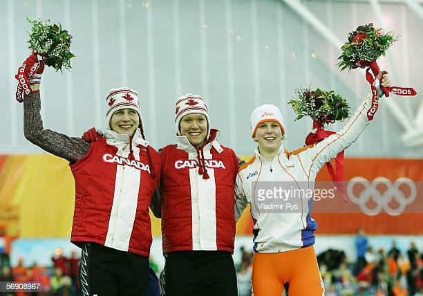 Kristina Groves silver of Canada Cindy Klassen gold of Canada and Ireen Wust of the Netherlands bronze celebrate after winning in the 1500m women's...