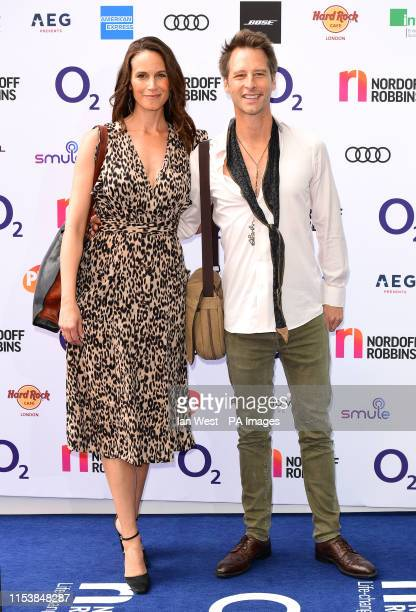 Kristina Hawkes and Chesney Hawkes attending the O2 Silver Clef Awards at the Grosvenor House Hotel London