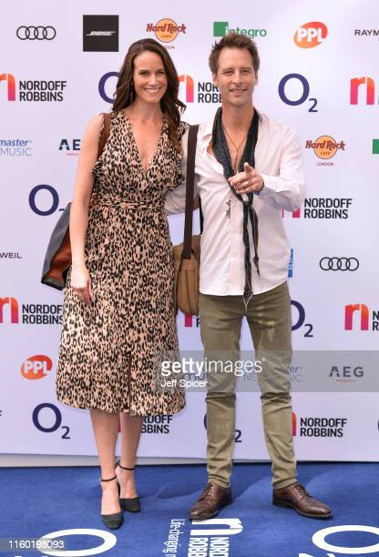 Kristina Hawkes and Chesney Hawkes attends the Nordoff Robbins O2 Silver Clef Awards 2019 at the Grosvenor House on July 05 2019 in London England