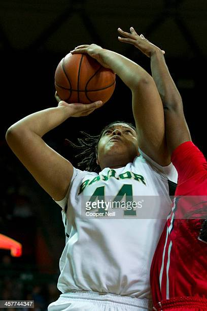 Kristina Higgins of the Baylor Bears drives to the basket against Danielle McCray of the Mississippi Lady Rebels on December 18 2013 at the Ferrell...