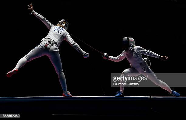 Kristina Kuusk of Estonia competes against Olga Kochneva of Russia during the Women's Epee Team Bronze Medal Match bout on Day 6 of the 2016 Rio...
