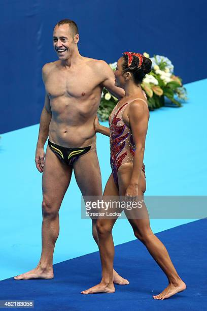 Kristina Lum Underwood and Bill May of the United States react after competing in the Mixed Duet Free Synchronised Swimming Preliminary on day four...