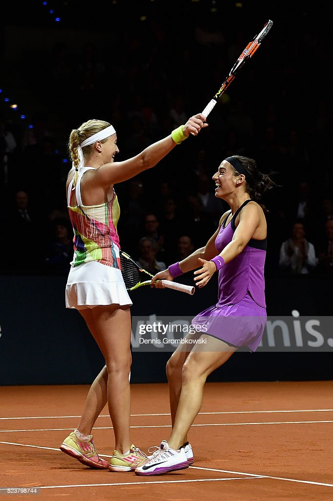 Kristina Mladenovic and Caroline Garcia of France celebrate match point in the doubles final against Martina Hingis of Switzerland and Sania Mirza of India on Day 7 of the Porsche Tennis Grand Prix at Porsche-Arena on April 24, 2016 in Stuttgart, Germany.