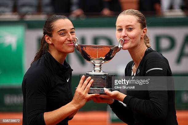 Kristina Mladenovic and Caroline Garcia of France lift the trophy following their victory during the Ladies Doubles final match against Elena Vesnina...