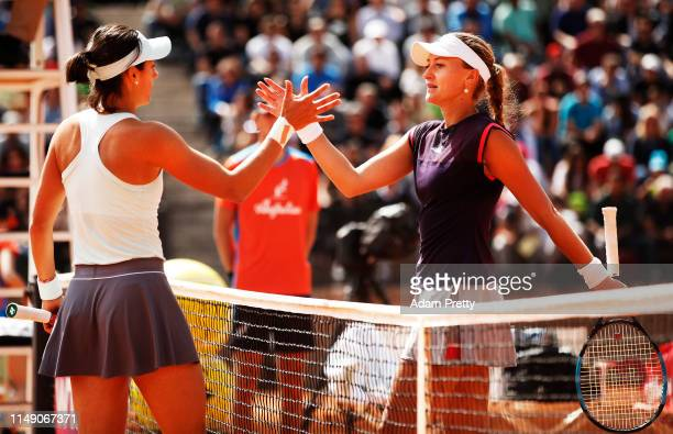 Kristina Mladenovic and Caroline Garcia of France shake hands after their first round match during day three of the International BNL d'Italia at...