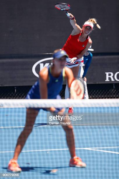 Kristina Mladenovic and Timea Babos of Hungary compete in their first round women's doubles match against Xenia Knoll of Switzerland and Natela...