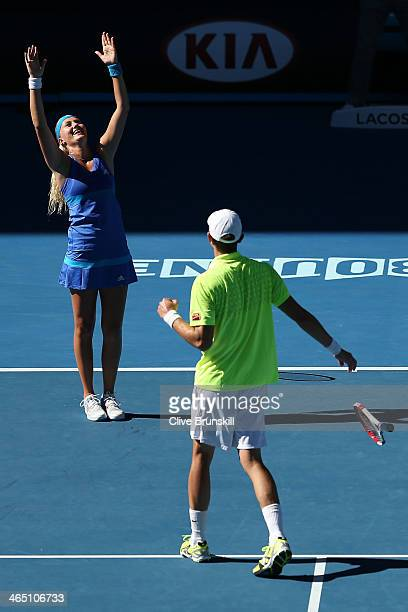 Kristina Mladenovic of France and Daniel Nestor of Canada celebrate winning their mixed doubles final match against Sania Mirza of India and Horia...