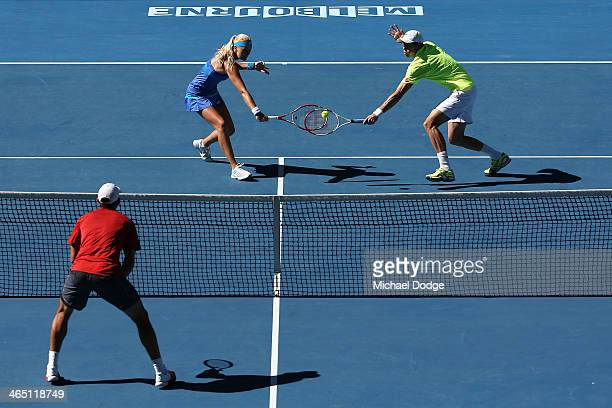 Kristina Mladenovic of France and Daniel Nestor of Canada clash racquets in their mixed doubles final match against Sania Mirza of India and Horia...