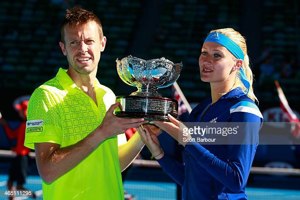 Kristina Mladenovic of France and Daniel Nestor of Canada pose with the winners trophy after their mixed doubles final match against Sania Mirza of...
