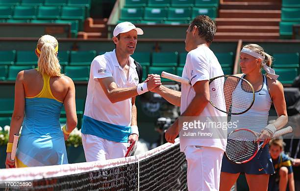 Kristina Mladenovic of France and Daniel Nestor of Canada congratulate winners Frantisek Cermak and Lucie Hradecka of Czech Republic after their...