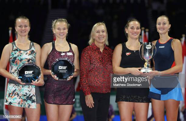 Kristina Mladenovic of France and Timea Babos of Hungary and Barbora Krejcikova and Katerina Siniakova of the Czech Republic pose with WTA legend...