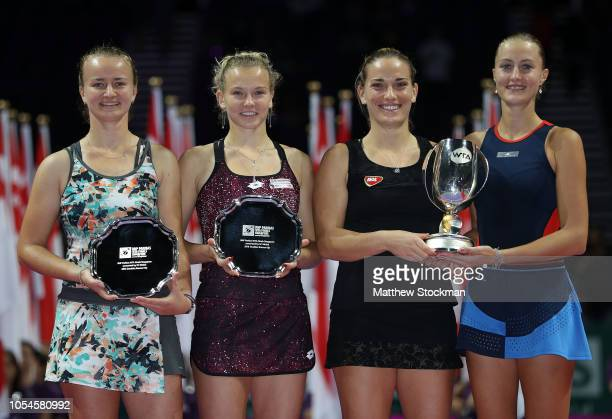 Kristina Mladenovic of France and Timea Babos of Hungary and Barbora Krejcikova and Katerina Siniakova of the Czech Republic pose with their trophies...