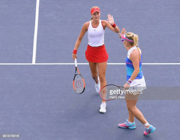 Kristina Mladenovic of France and Timea Babos of Hungary celebrate a point in their match against Andrea Hlavackova of the Czech Republic and Monica...