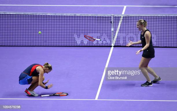 Kristina Mladenovic of France and Timea Babos of Hungary celebrate match point against Barbora Krejcikova and Katerina Siniakova of the Czech...