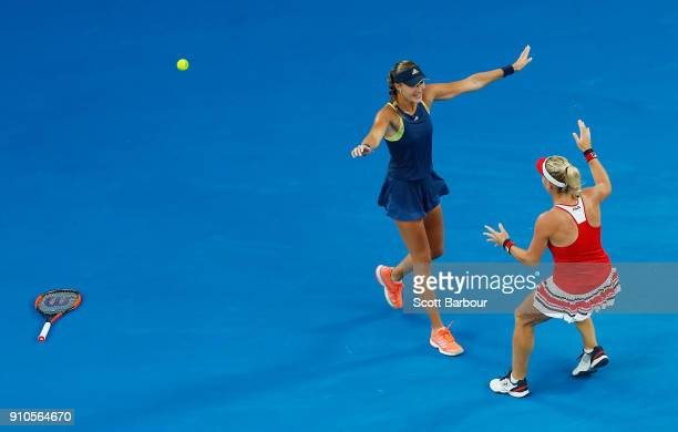 Kristina Mladenovic of France and Timea Babos of Hungary celebrate after winning the women's doubles final against Ekaterina Makarova of Russia and...