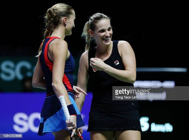 Kristina Mladenovic of France and Timea Babos of Hungary play Ashleigh Barty of Australia and CoCo Vandeweghe of the United States in the Women's...
