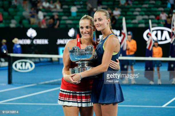 Kristina Mladenovic of France and Timea Babos of Hungary pose for a photo with the championship trophy after winning the women's doubles final...