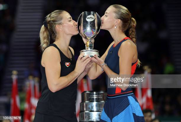 Kristina Mladenovic of France and Timea Babos of Hungary pose with the Martina Navratilova trophy after winning their match against Barbora...