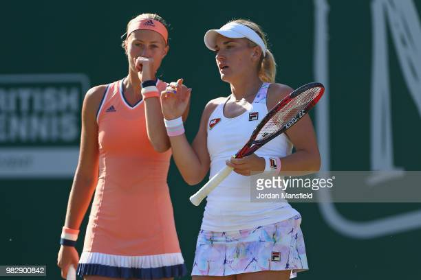 Kristina Mladenovic of France and Timea Babos of Hungary talk tactics during their doubles Final match against Elise Mertens of Belgium and Demi...