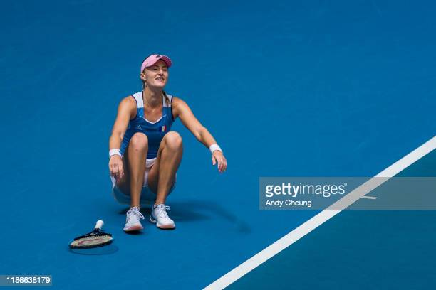 Kristina Mladenovic of France celebrates after winning the Day 2 match against Ashleigh Barty of Australia in the 2019 Fed Cup Final tie between...