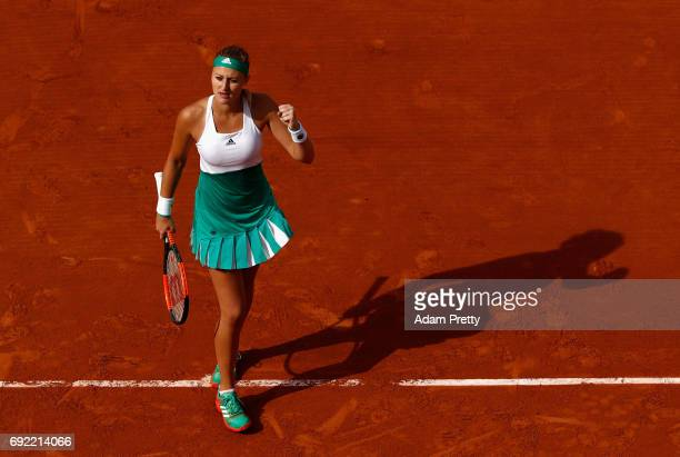 Kristina Mladenovic of France celebrates during the ladies singles fourth round match against Gabine Muguruza of Spain on day eight of the 2017...