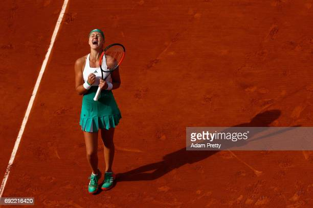 Kristina Mladenovic of France celebrates victory in the ladies singles fourth round match against Gabine Muguruza of Spain on day eight of the 2017...