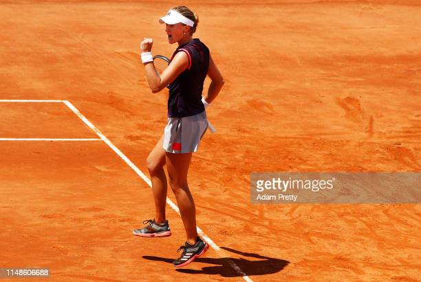 Kristina Mladenovic of France celebrates winning match point during her match against Amanda Anisimova of the USA during day 1 of the Internazionali...