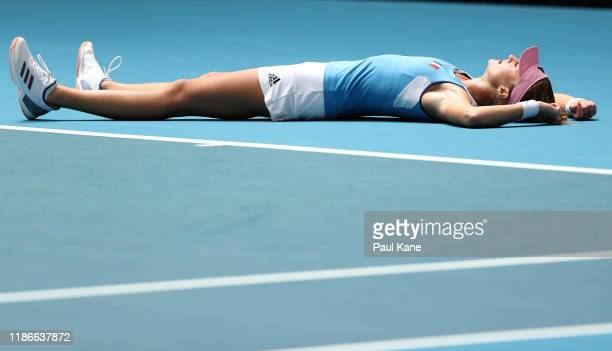 Kristina Mladenovic of France celebrates winning the match against Ash Barty of Australia in the 2019 Fed Cup Final tie between Australia and France...