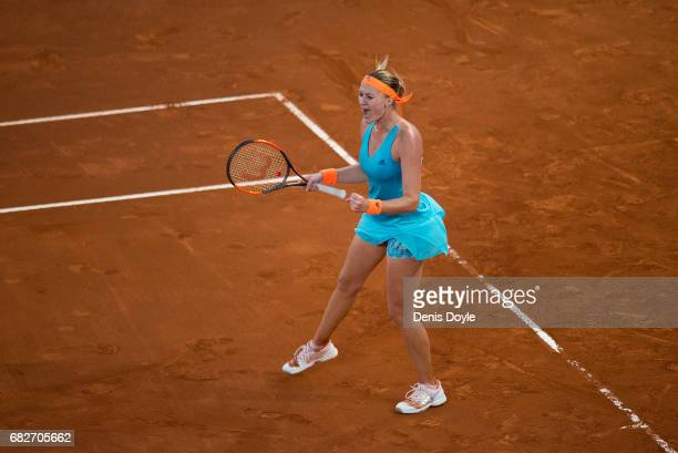 Kristina Mladenovic of France celebrates winning the second set tiebreak against Simona Halep of Romania in their final match during day eight of the...