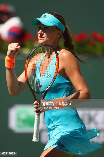 Kristina Mladenovic of France celebrates winning the second set tie break against Caroline Wozniacki of Denmark in their quarter final match during...