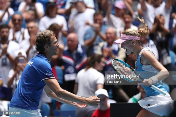 Kristina Mladenovic of France celebrates with Julien Benneteau, France Fed Cup Captain after winning the match against Ash Barty of Australia in the...