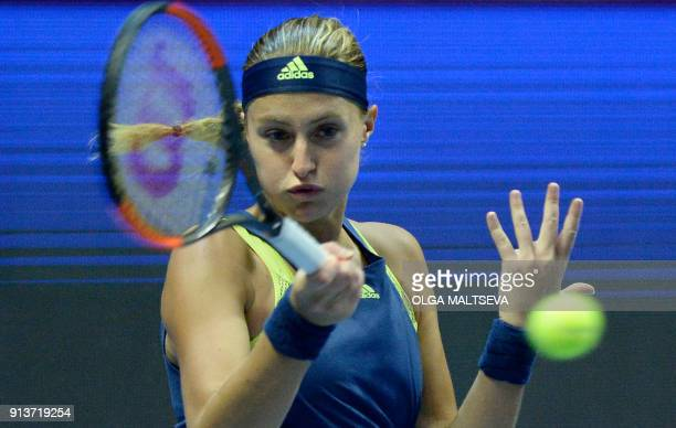 Kristina Mladenovic of France hits a return to Daria Kasatkina of Russia during their Saint Petersburg WTA tennis tournament semifinal match in Saint...