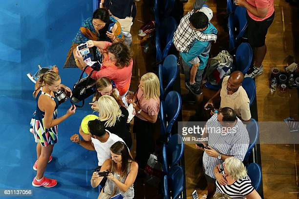 Kristina Mladenovic of France holds the Hopman Trophy while signing autographs after defeating Coco Vandeweghe and Jack Sock of the United States in...